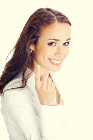 come up to: Portrait of young happy smiling business woman with follow me gesure Stock Photo