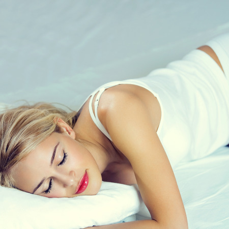 lazyness: Portrait of young sleeping lovely woman at bedroom