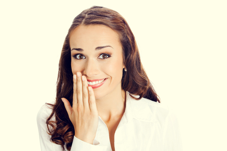 young woman smiling: Portrait of happy smiling young business woman covering with hand her mouth