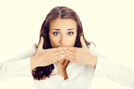 hearsay: Portrait of surprised excited young business woman covering with hands her mouth