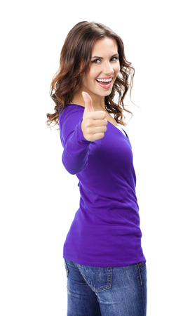 Happy smiling beautiful young woman showing thumbs up gesture, in violet casual clothing, isolated over white background Standard-Bild