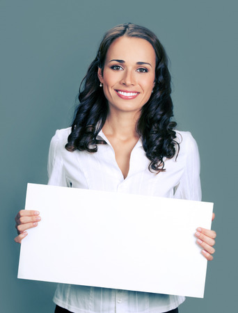 copyspace: Cheerful young businesswoman showing blank signboard with blank copyspace area for text or slogan