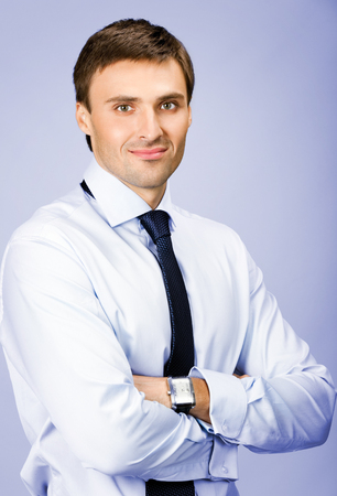 males only: Portrait of young happy smiling business man, over violet background
