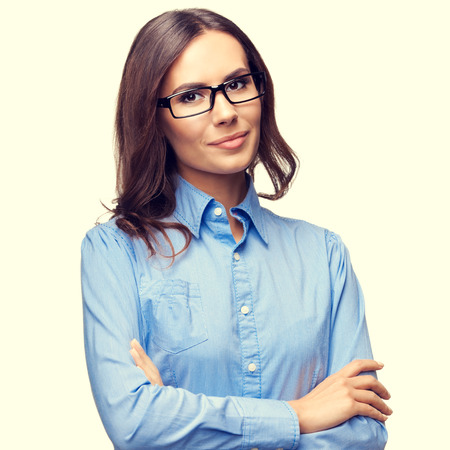 Office women: Portrait of smiling young businesswoman in glasses, in crossed arms pose, square composition