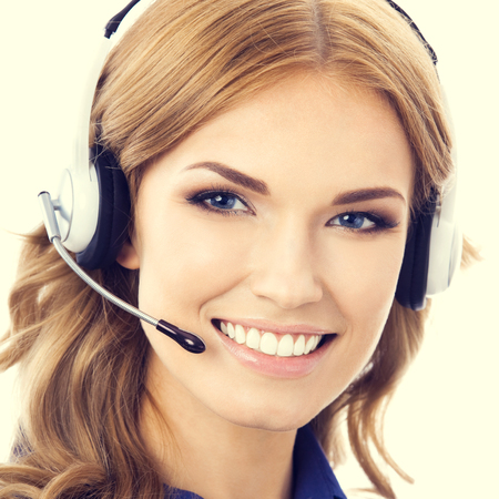 woman on phone: Portrait of happy smiling beautiful young female support phone operator or phone worker in headset and blue clothing. Customer service assistance concept.