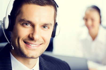 Two support phone operators at office, customer service concept