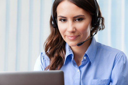 operator: Portrait of happy smiling cheerful beautiful young support phone operator in headset, at office