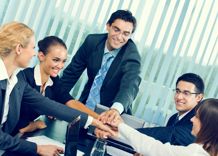 Happy successful gesturing business team at office Stock Photo