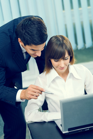 net meeting: Two businesspeople working together at office