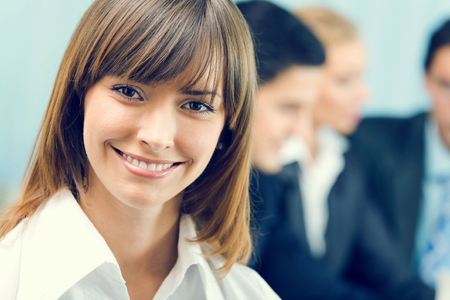 Portrait of successful businesswoman and business-team at office meeting Stock Photo