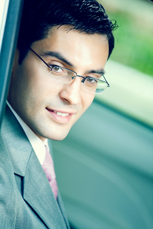 businessman suit: Portrait of young happy smiling businessman in the car