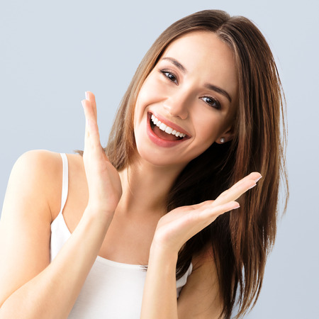 young woman showing smile, in casual smart clothing