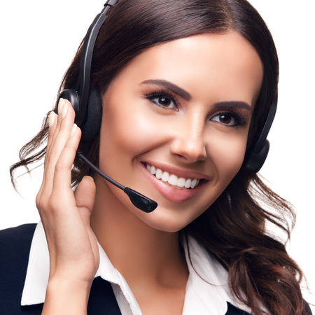 white suit: Portrait of smiling customer support phone operator, isolated against white background