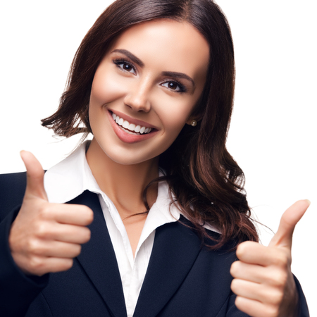 over white: Happy smiling beautiful young businesswoman showing thumbs up gesture, isolated against white background Stock Photo