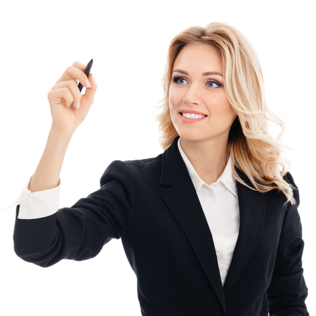 Happy smiling cheerful young businesswoman writing or drawing something on screen or transparent glass, by blue marker, isolated over white background