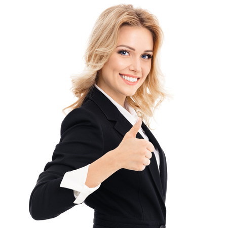 Happy smiling beautiful young businesswoman showing thumbs up gesture, isolated against white background Stock Photo