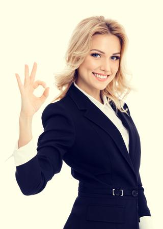 okay: Happy smiling beautiful young businesswoman showing okay gesture