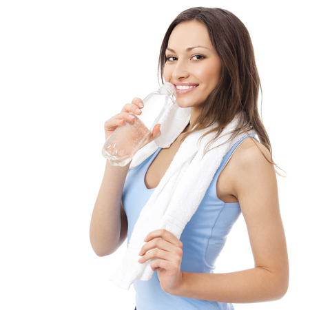 water aerobics: Portrait of happy smiling young woman in fitness wear with bottle of water, isolated over white background Stock Photo