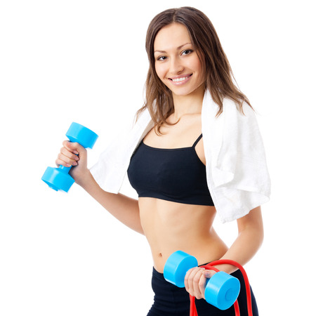 expander: Portrait of young happy smiling woman in fitness wear with dumbbell, ball and expander, isolated over white background