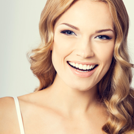 young woman face: Portrait of young cheerful smiling woman