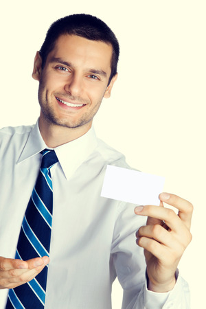 debet: Portrait of smiling businessman showing blank business or plastic card