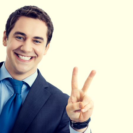2 persons only: Happy smiling senior businessman showing two fingers or victory gesture. Success in business concept.