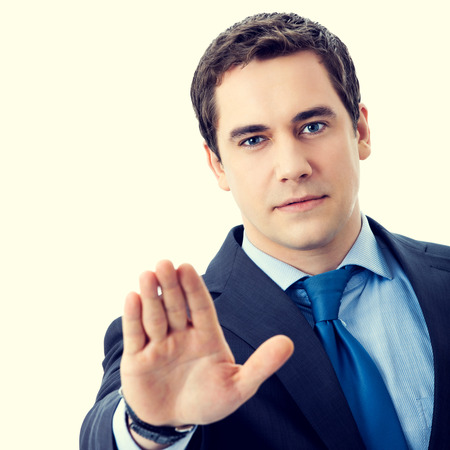 stop gesture: Serious senior businessman showing stop gesture Stock Photo