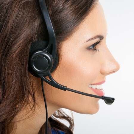 visage femme profil: Profile view of happy smiling young support phone operator or businesswomen in headset