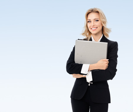 blondy: Portrait of young happy smiling businesswoman with grey folder, with blank copyspace area for slogan or text, on blue background
