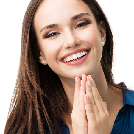 Portrait of happy gesturing smiling young woman in casual smart blue clothing, isolated against white background