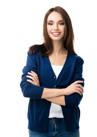whitebackground: Portrait of young smiling woman in casual smart blue clothing with crossed arms, isolated against white background