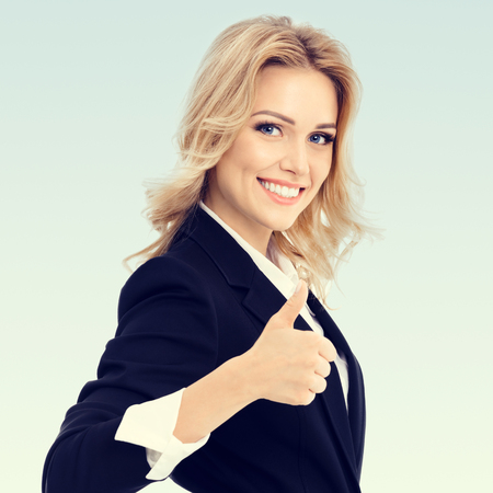 blondy: Happy smiling beautiful young businesswoman showing thumbs up gesture