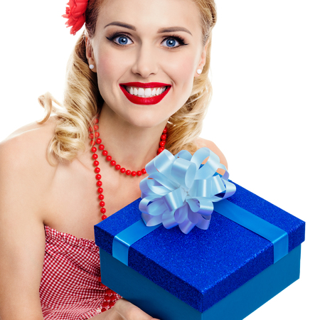 upsweep: Portrait of beautiful young happy smiling woman in pin-up style clothing, isolated over white background. Caucasian blond model posing in retro fashion and vintage concept studio shoot. Stock Photo