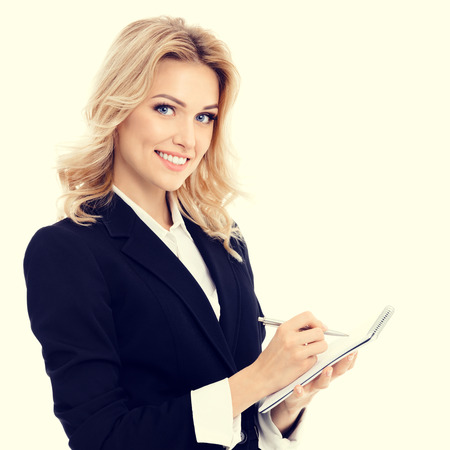 blondy: Portrait of young beautiful businesswoman with clipboard writing