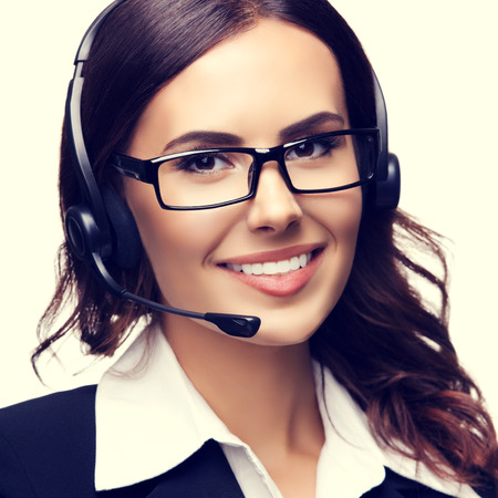 handsfree phone: Portrait of smiling customer support phone operator in glasses