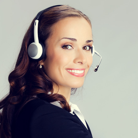 hotline: Portrait of happy smiling cheerful customer support phone operator in headset