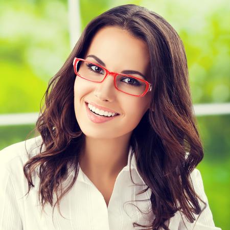 Portrait of young happy brunette businesswoman
