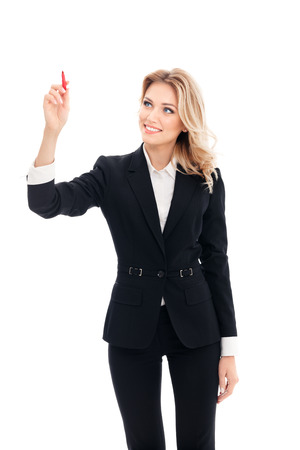 glassboard: Happy smiling cheerful young businesswoman writing or drawing something on screen or transparent glass, by blue marker, isolated on white background. Caucasian blond model in business success concept.
