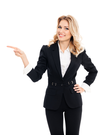 Happy smiling young businesswoman, showing something, some product or blank copyspace area for advertise slogan or text message, on white background. Caucasian blond model in business success concept.