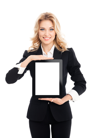 Smiling beautiful young businesswoman showing blank no-name tablet pc monitor with copyspace area for slogan or text message, isolated on white background. Caucasian blond model in business concept shoot. Stock Photo