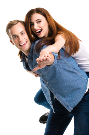 young happy couple: Portrait of young playful happy couple, in piggyback pose, looking at camera with smile. Caucasian models in love, relationship, dating, flirting, lovers, romantic concept, isolated over white background.
