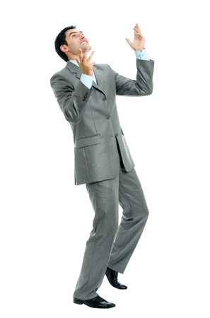 Very happy successful gesturing businessman, isolated on white background. Success in business concept studio shot. Stock Photo