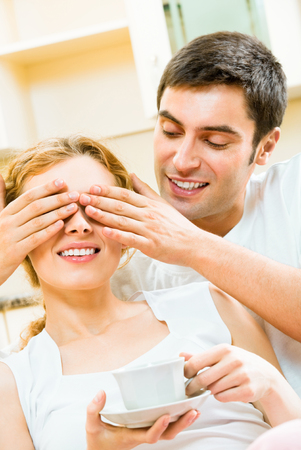 flirtation: Young happy amorous couple having fun at home. Love, relations, romantic concept shot.