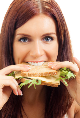 Hungry gluttonous woman eating sandwich with cheese, isolated on white background. Healthy eating and vegetarian dieting concept studio shot. Stock Photo