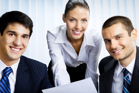 business partnership: Businesspeople working with document at office. Success in business, partnership and teamwork theme concept.