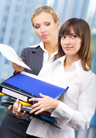 Two businesswomen working with documents at office. Success in business, partnership and teamwork theme concept. Stock Photo