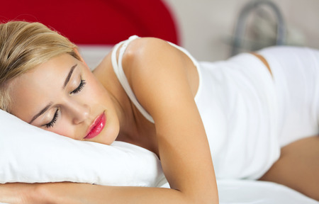 lazyness: Portrait of young sleeping woman at bedroom. Healthy lifestyle concept. Stock Photo
