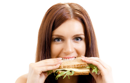 Very hungry gluttonous woman eating sandwich with cheese, isolated on white background. Dieting and weight lossing concept. Stock Photo