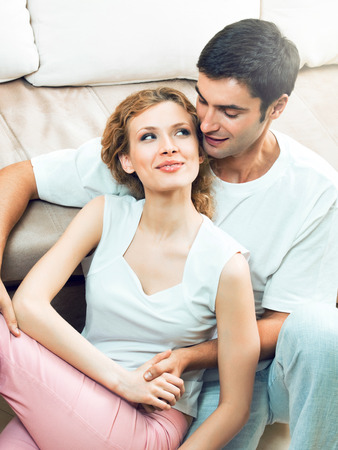 amorous: Portrait of young happy amorous couple at home
