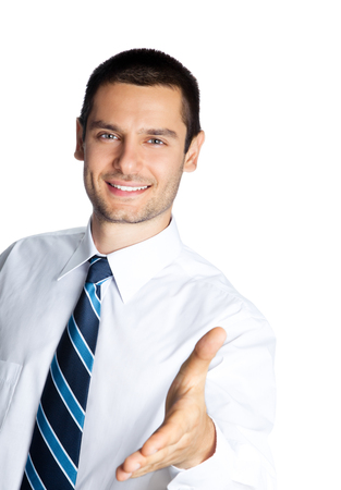 give out: Portrait of happy smiling businessman giving hand for handshake, isolated on white background. Success in business, job and education concept studio shot. Stock Photo